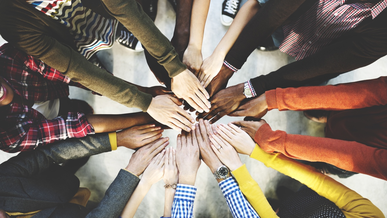 Image of Volunteers Hand on Hands